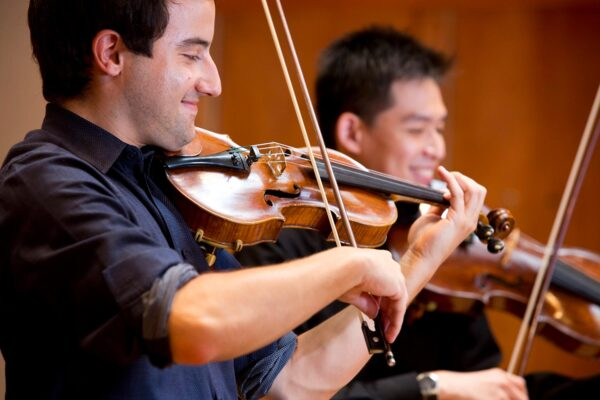 Students in a string quartet