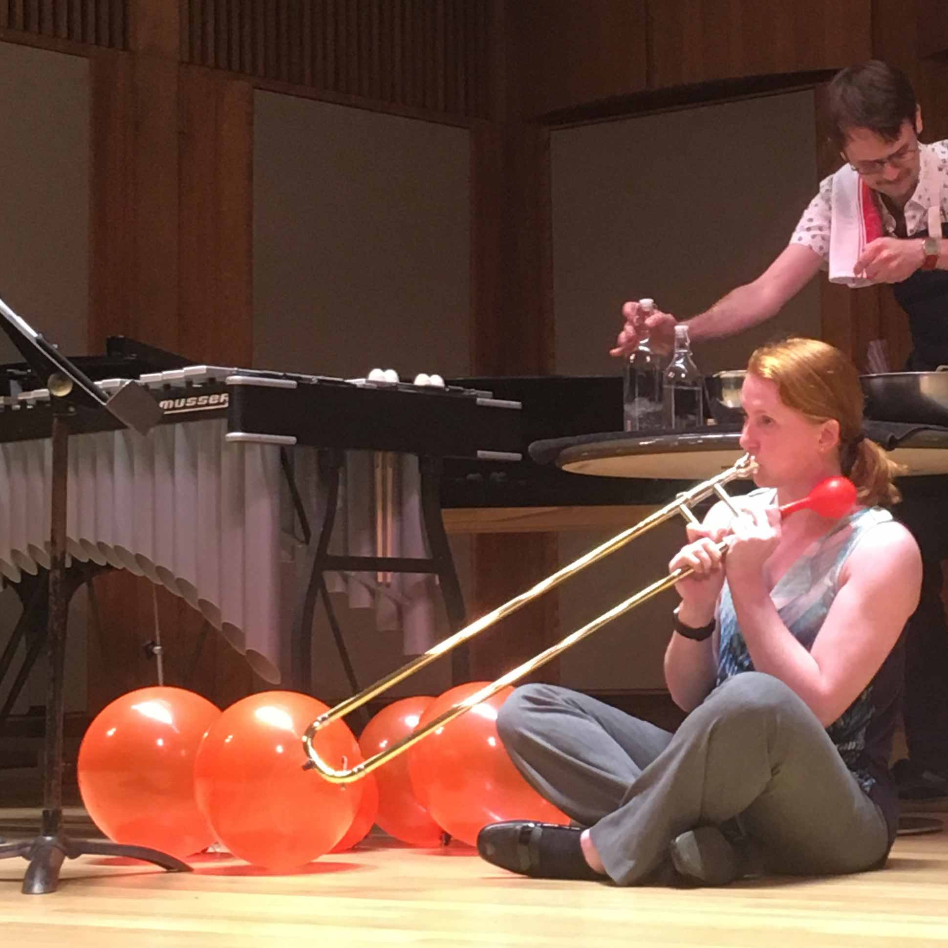 Musician uses trombone to inflate balloons